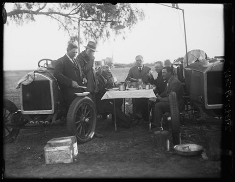 The vice-regal party at breakfast: (from left) Sir Henry Barwell, William Webb, Thomas McCallum, NG Bell, Sir Tom Bridges, Murray Aunger and Captain Hambleton, central Australia 1923. Three Dort four-cylinder cars were customised for the expedition and fitted with the largest tyres possible. Two carried luggage, equipment and fuel, while the third seated four expeditioners.