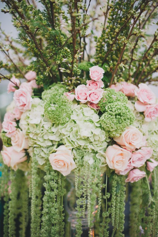 Love the dripping , tall feel of this arrangement.  Perfect for reception flowers.