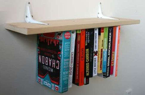 Up-side down book shelf. I my self would hide the brackets. Genius!
