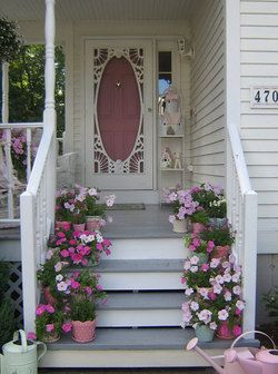 #springintothedream  Front Porch Inspiration:  Flowers on Porch Steps.  Pretty and vintage in pink ...