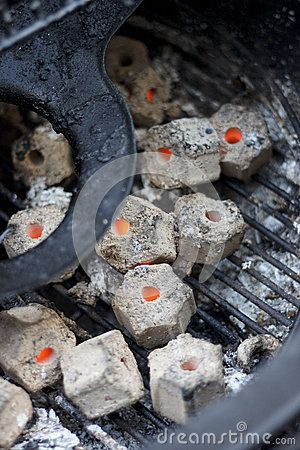 Perfect burning charcoal briquettes  inside grill