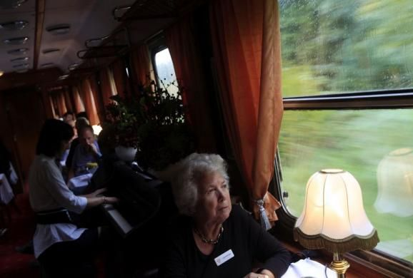 A passenger looks out of the window of the bar car of a historic Tehran-bound train as it leaves Budapest October 15, 2014. REUTERS/Bernadett Szabo. visit http://www.budpocketguide.com #Iran #Persia #Tehran #Budapest #TravelToIran #MyIran #Travel2Budapest #MyBudapest