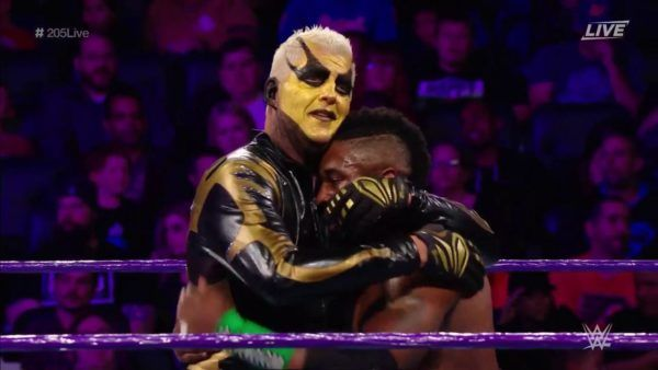 205 goes gold, as Goldust tags with Cedric Alexander on the show. TJP returns to...