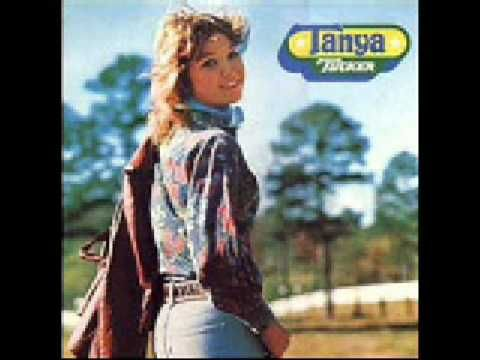 "Tanya Tucker  ""San Antonio Stroll""  Released: 1975  Album: Tanya Tucker    Lyrics:    When I was a child down in South Caroline  Soon as Saturday sun went on down.  My folks and sister would go and leave me home all alone,  Going to that big square dance in town.  Well my old radio would play that old opry show,  So I never got lonesome or blue...."