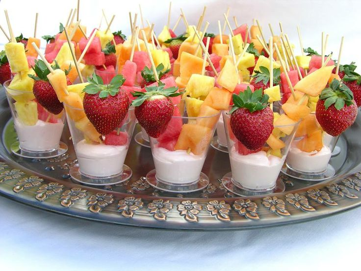 Looks good...still don't do yogurt. I'll need to find a good substitute to provide the base. Maybe ice cream or sherbet and serve as a dessert.   Individual Fruit Cups with Yogurt    Plastic cups Wooden skewers Vanilla yogurt 1 Strawberry for each cup 1 Skewer of pineapple chunks 1 Skewer of watermelon 1 Skewer of cantaloupe Assemble and display on a pretty party platter.