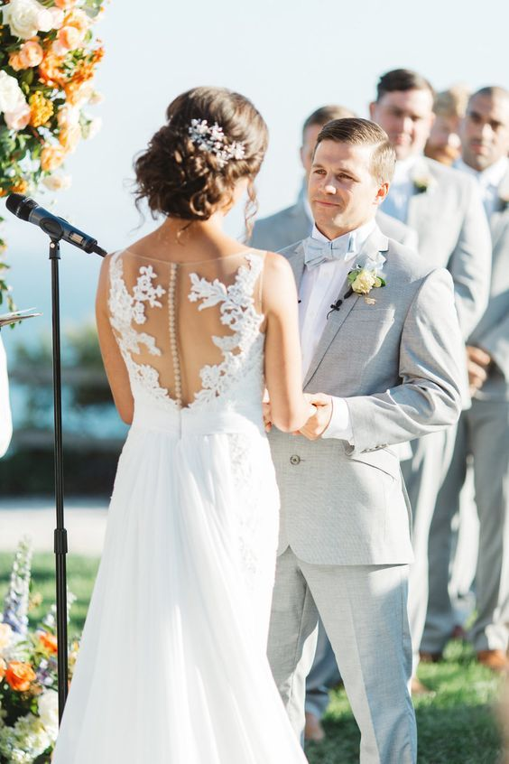 Lace wedding dress with illusion back and groom in light grey suit  | Weddings | Real Weddings | Wedding Decorations | #weddings #weddingdecor #bride #weddingphotography| www.starlettadesigns.com