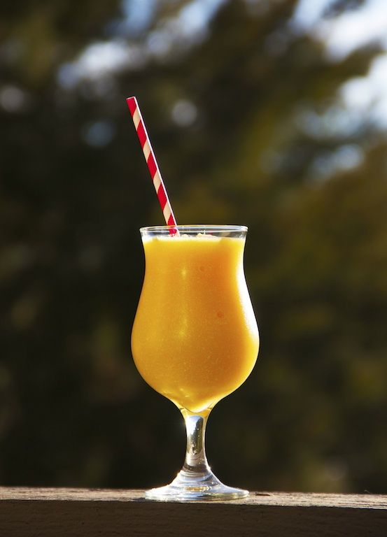 Frozen Peach Daiquiri: Blend 4oz white rum, 1/2c orange juice, 1Tbsp cream of coconut, 2c frozen peach slices, 1Tbsp sugar, 2c ice cubes.