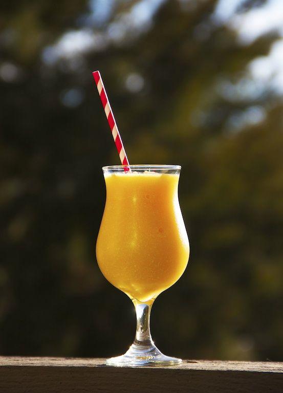 Frozen Peach Daiquiri: Blend 4oz white rum, 1/2c orange juice, 1Tbsp cream of coconut, 2c frozen peach slices, 1Tbsp sugar, 2c ice cubes.