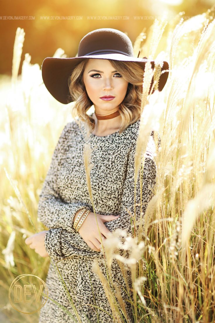 Senior picture portrait ideas backlit outdoor fall leaves sweater floppy hat