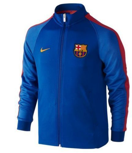 NIKE FC BARCELONA AUTHENTIC N98 YOUTH Sport Royal/Gym Red/University Gold WARM COVERAGE. PURE COMFORT. The FC Barcelona Authentic N98 Big Kids' Track Jacket is designed for warmth in colder weather. D