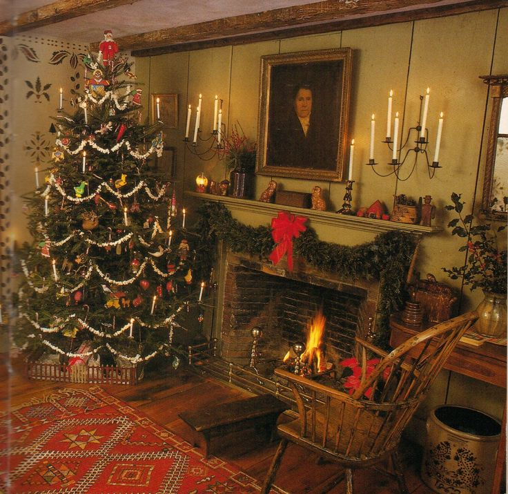 Amazing room! Great Early American Colonial design, paired with a country primitive Christmas Tree with popcorn garland, handmade folk ornaments and candles.  Beautiful wall stencils and a roaring fireplace creates a cozy interior.