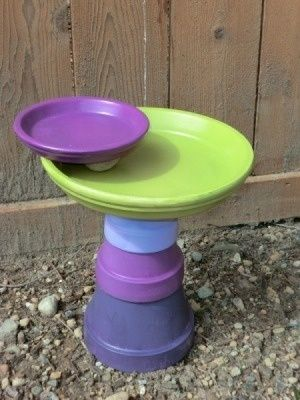 painted clay pots ideas | DIY birdbath made from painted clay pots and pot bottoms.