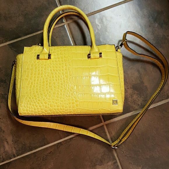 Kate Landry bright yellow purse Get ready for spring with this bright yellow purse. Has button closure, 2 zipper pockets running the full length of the purse, an inside pocket and a zipper inside pocket. EUC Kate Landry Bags Crossbody Bags
