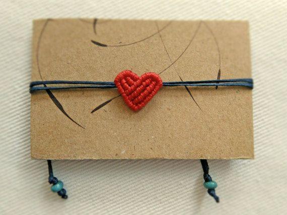 Makrame bracelet with a small heart. Green beige by KnotknotBijoux