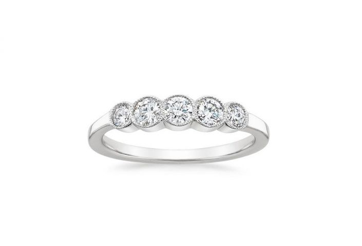 ''Fortuna'' 5 Diamonds Wedding Ring Five dazzling round bezel-set diamonds are embellished by subtle milgrain, adding to the modern yet timelessly romantic look of this diamond ring.