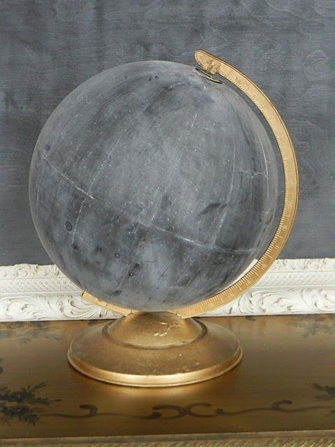 Paint a globe with chalkboard paint. Write your own story on the world.