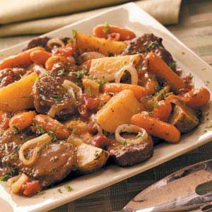 """Slow Cooker Swiss Steak Supper Recipe -The satisfying slow-cooked dinner comes from Kathleen Romaniuk of Laval, Quebec. TIP: """"To save a step, I keep peppered seasoned salt on hand to use instead of the seasoned salt and pepper,"""" Kathleen notes."""