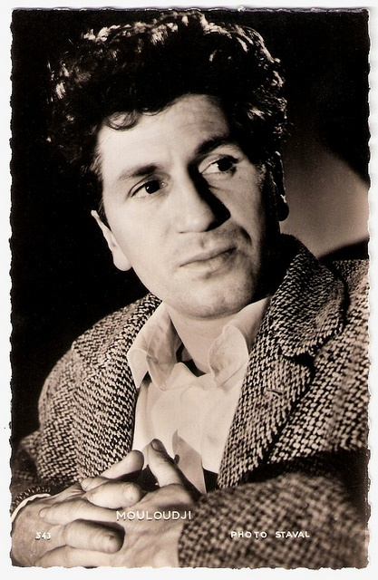 French actor and singer-songwriter (Marcel) Mouloudji (1922-1994) was already a film star at the age of 16. Angelic and raven-curled, he appeared in one film after another, but he is now best remembered for his politically engaged songs, among which Boris Vian's masterpiece Le Déserteur. He was a free and libertarian artist...