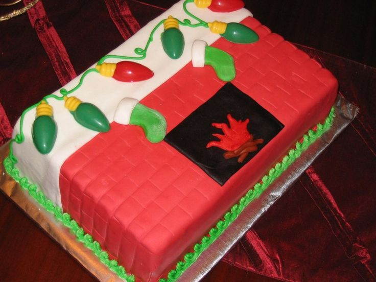 sheet cake covered in fondant and decorated with molded chocolate lights.