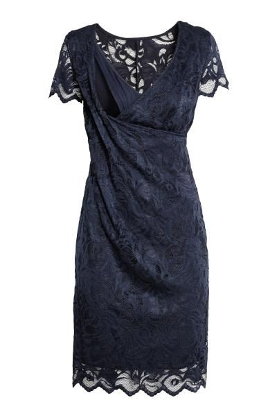 Short-sleeved lace nursing dress. Wrapover front with a jersey inner top for easier nursing access. Jersey lining.