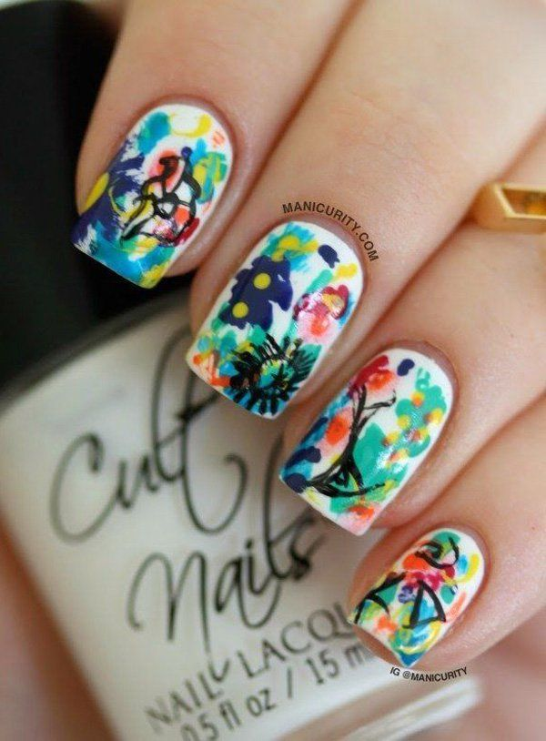 Draw abstract figures on your nails using a variety of fun colors. Paint an entire garden with different polishes that easily complement each other. source