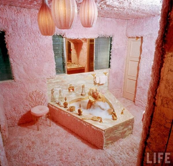 In November 1957 (shortly before her marriage to Hargitay), Mansfield bought a 40-room Mediterranean-style mansion formerly owned by Rudy Vallee at 10100 Sunset Boulevard in Beverly Hills. Mansfield had the house painted pink, with cupids surrounded by pink fluorescent lights, pink furs in the bathrooms, a pink heart-shaped bathtub, and a fountain spurting pink champagne, and then dubbed it The Pink Palace. Hargitay, a plumber and carpenter before getting into bodybuilding, built a pink…