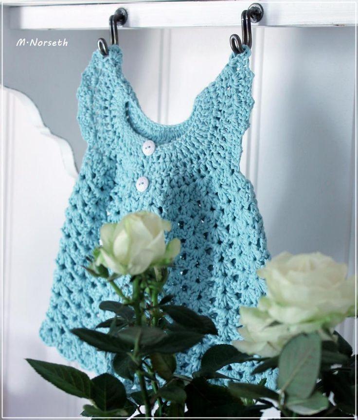 Lovely crochet dress for baby.  Pattern at www.dottiedee.no /nettbutikk Design: Monica Norset