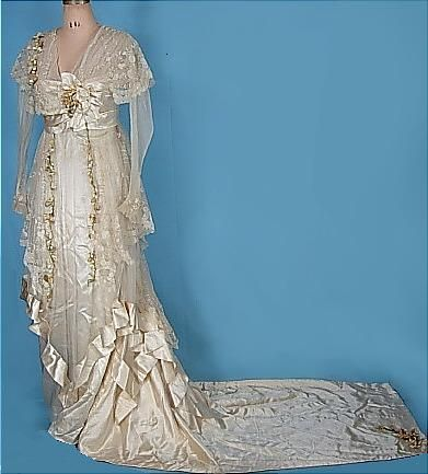 Early 1910s Ecru Satin Trained Wedding Gown with Lace, Wax Orange Blossoms, and Original Veil. Debenham & Freebody, London. (front)