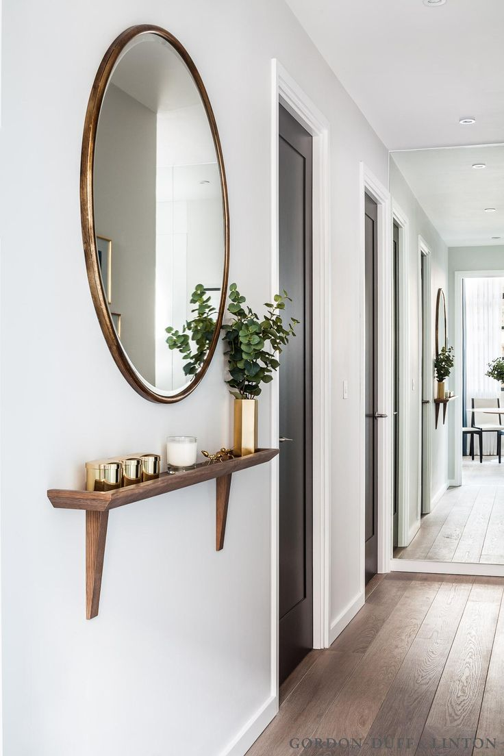 narrow hallway shelf and round mirror for