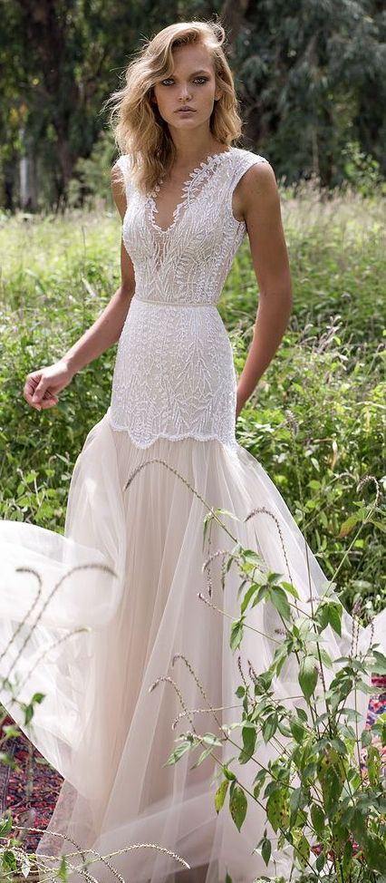 Breathtakingly gorgeous sleeveless illusion neckline wedding dress with blush tulle skirt; Featured Dress: Limor Rosen