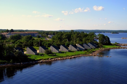 """Atlantica Hotel and Marina Oak Island   (Nova Scotia). """"You can see Mahone Bay and Oak Island from one of the hotel's 13 two-bedroom oceanfront chalets, about 45 minutes from Halifax. In addition to soaking in views of the Bluenose Coast of Nova Scotia's South Shore, you can grill your own dinner (thanks to a barbecue pit) or relax in front of a stone fireplace on a private deck. Some of the 105 rooms at this hotel have oceanfront views and balconies."""""""