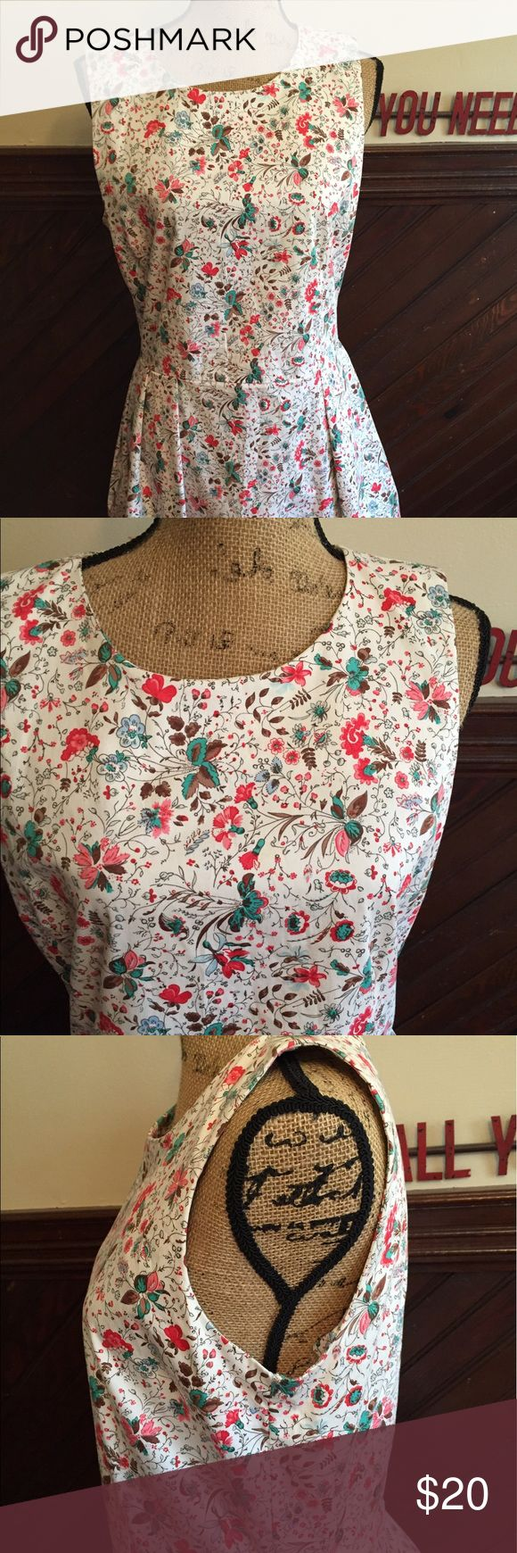Fun and flirty dress with small flowers Love this because it's fun and bouncy- great with a pair of cowboy boots- has pockets which are a plus and flares out to accentuate a small waist GAP Dresses