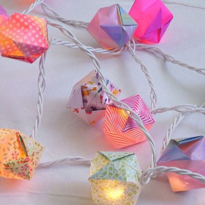 I've made a few of these Origami light covers, they are so fun great for weddings or parties!