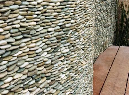 Standing Earth Pebble Tile from Pebble Tile Mosaics. Each stone is cut in half and then adhered to a durable mesh backing. This tile can be used for bathroom and kitchen tile, indoor and outdoor showers, wall cladding and as a backsplash tile.