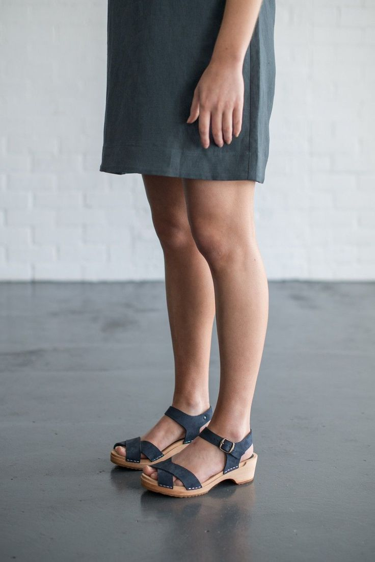 funkis clogs & sandals are all made in Sweden using leather and locally sourced timber. Made of timber wood base and rubber grip sole, low 7cm heel, navy suede leather and bronze buckle detail, our clogs are an easy fit and very comfortable to wear.