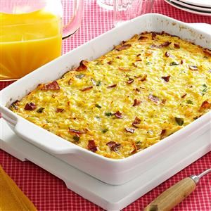 """Cheesy Hash Brown Egg Casserole with Bacon Recipe -""""Isn't it about time for you to make your 'egg pie?'"""" my husband and sons inquire, using the nickname they've given this hearty casserole. It's nice enough for a special brunch and versatile enough for a satisfying family supper. —Patricia Throlson, Willmar, Minnesota"""