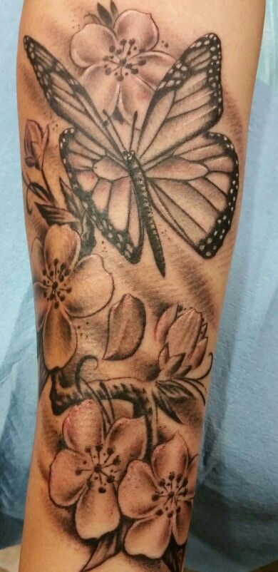 Butterfly and cherry blossoms  tattoo by Steve'O Never Lost Tattoo sacramento california  916-640-4084
