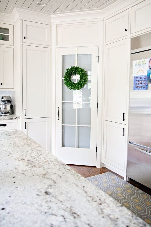Pantry door with window!!! And I love the idea of putting a wreath on the pantry door. Utah Custom Home Builder | Home Remodeling Company Utah | Beehive State Builders #beehivestatebuilders #kitchenremodel