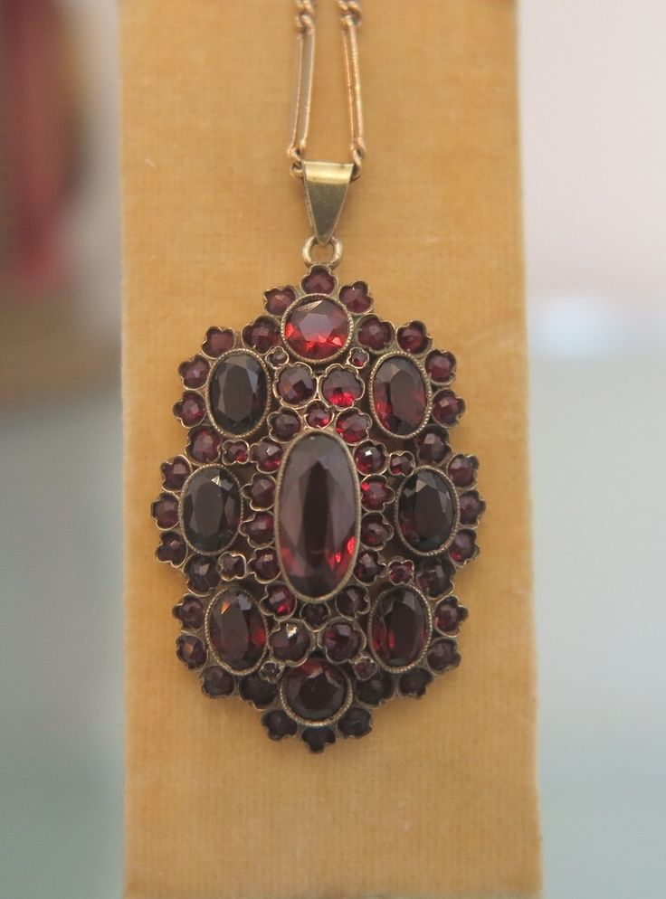 295 best antique bohemian garnet jewelry images on pinterest oval bohemian garnet pendant of outstanding quality the pendant consists of a large and fine facetted garnet in the center surrounded by a row of aloadofball Images