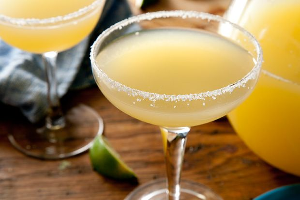Pitcher-Perfect Margarita  For the margarita:  8 cups cold water  1 liter 100 percent agave tequila, chilled  2 (12-ounce) cans frozen limeade, thawed in the refrigerator  4 ounces frozen concentrated orange juice (1/2 cup), thawed  1/4 cup fresh squeezed lime juice