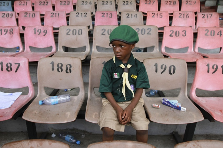 A boy scout sits after a parade marking the International Workers' Day celebration in Nigeria's commercial capital Lagos, May 1, 2012. REUTERS/Akintunde Akinleye