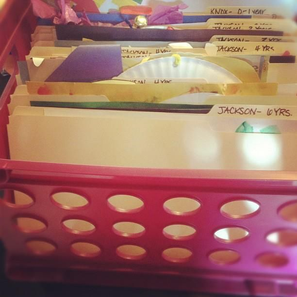 good idea for storing kids artwork quickly until I get around to a longer term scrapbook..some day?