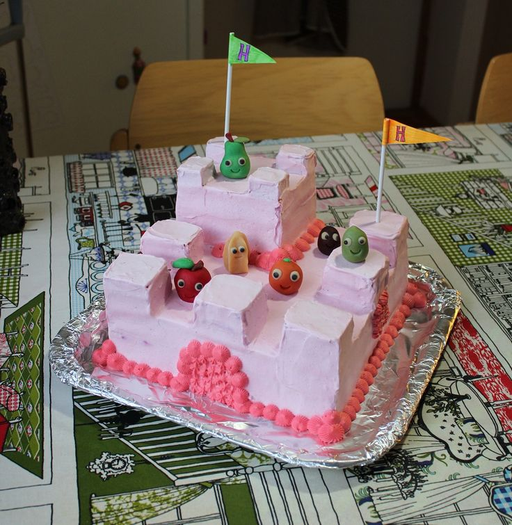 Castle cake with some fruit residents!