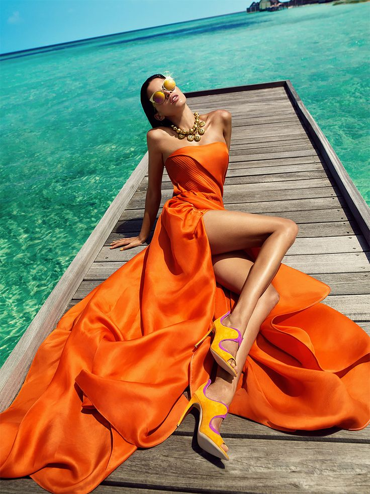 """Shot by photographer Luis Monteiro and retouched by Rob Dewey, """"Orange Crush"""" is a fashion editorial produced for VOGUE India. The series is about """"strong colours, shape, and natural beauty; deep blue sky and turquoise waters contrasted harmoniously with bold reds and oranges, and bronzed skin"""".  More fashion photography via Behance"""