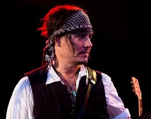 Johnny Depp took to the stage with his musical supergroup Hollywood Vampires, rocking out on his guitar at The Roxy Theatre in Los Angeles on Wednesday night, Sept 16, 2015. Hollywood Vampires album is on sale now.