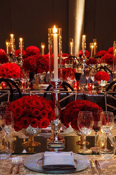Taper candles placed in tall silver candlesticks add tons of drama and opulence…