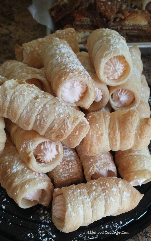 Strawberry Cream Horns. --The easy way! Puff pastry, cream cheese, cool whip, powdered sugar. Easy peasy!