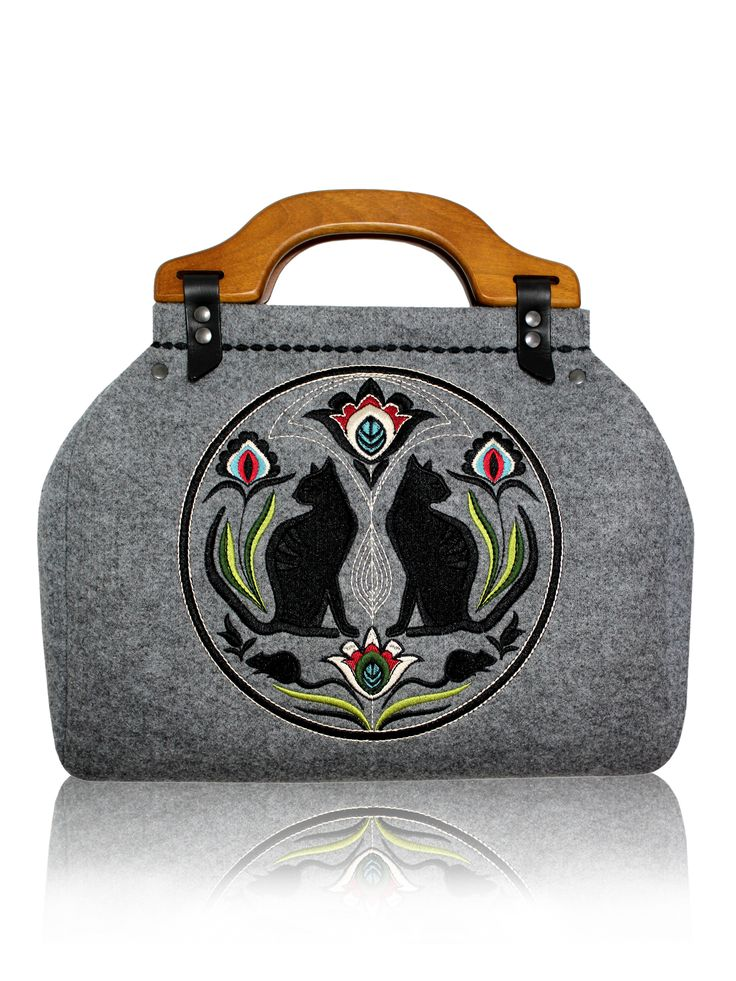 GOOD CAT SHAPE - Felt bag with embroidery - Coffer Bag FOLK KOTY The newest collection is inspired by the nature. The embroidery is inspired by cut-out in the Łowicz style. The bag has a claret satin lining inside. The whole makes a toned down composition, which can be a great addition to any day and night outfit. More: goshico.com