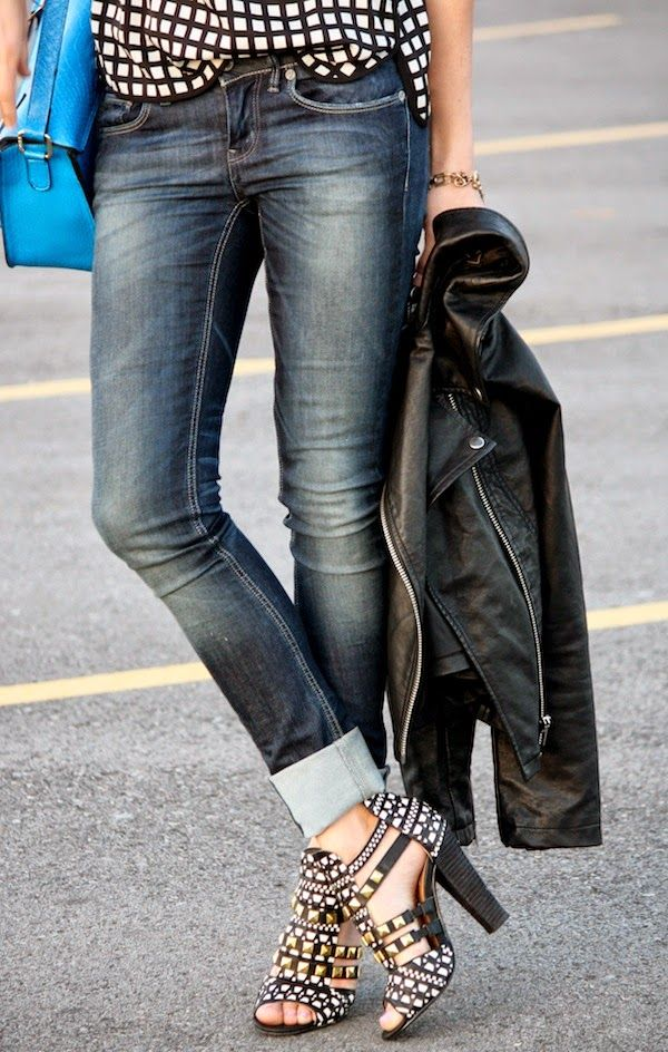 Must Have! Black and white checker top, cuffed jeans, leather jacket and those chunky-heeled shoes! Pop of color with the blue bag.