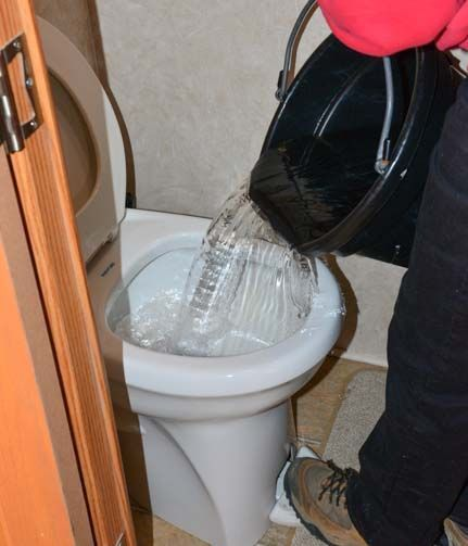 Pouring water down RV toilet